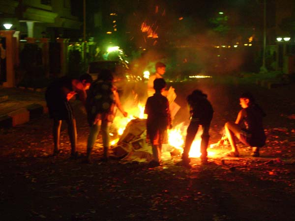 Bonfire in the middle of the street - what better way to clean up?