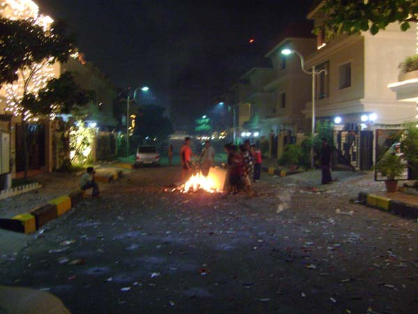 The street, littered with spent fireworks.