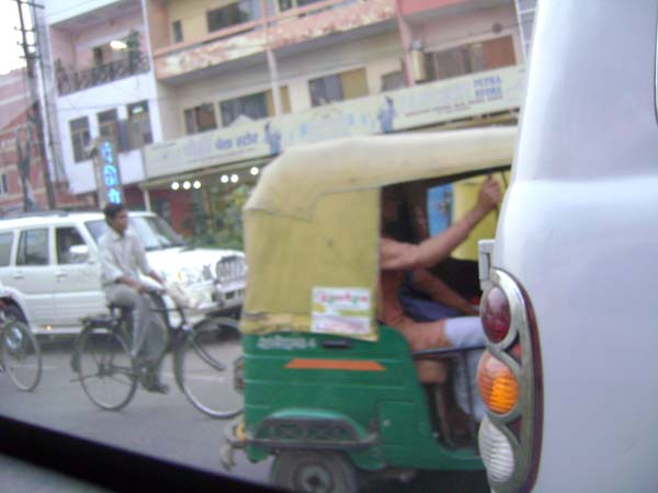 A photo of the crowded street (he was trying to get a picture of a green rickshaw)